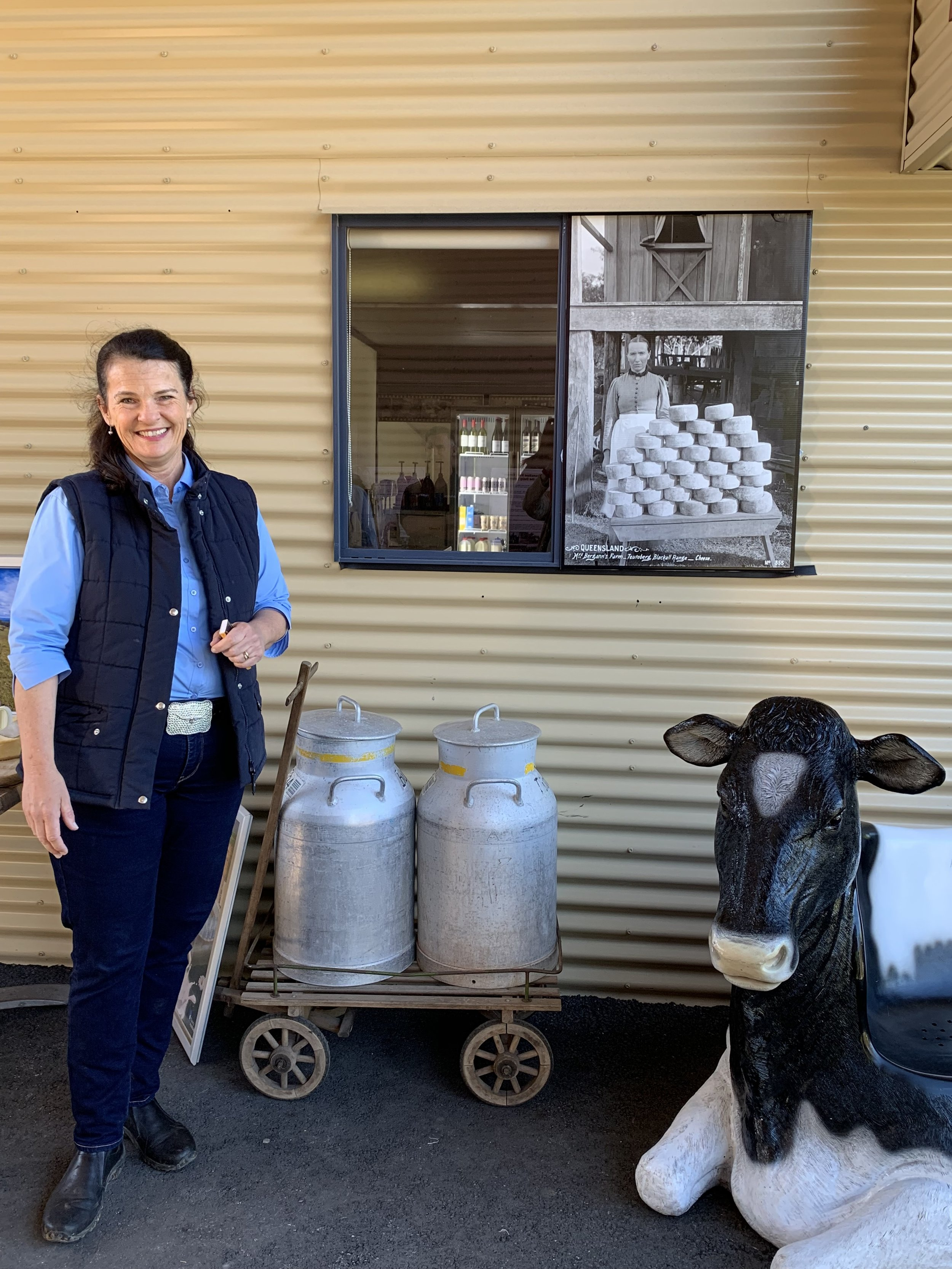 Generations a part. Sara Bucher of Maleny Cheese next to 120 yo photo of Mrs Bergman of Blackall Range Cheese