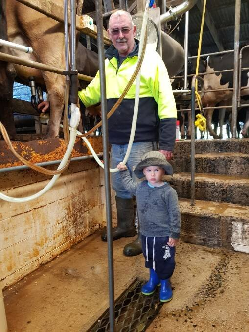 Millaa Millaa dairy farmer James Geraghty with grandson Charlie Daley are calling for fair milk prices.