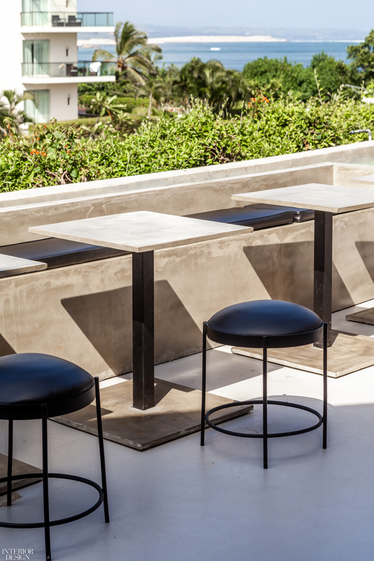 Exterior seating in concrete overlooks the boardwalk. Photography by Bali Interiors (Sheila Man).