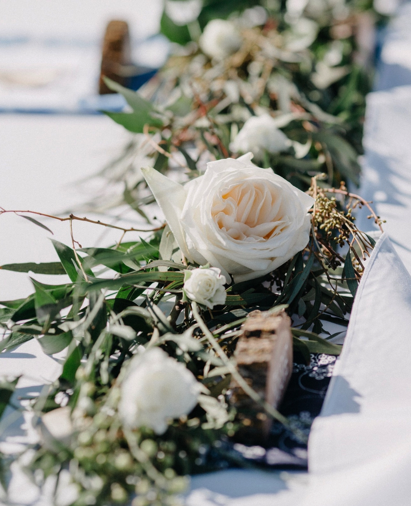 Table runner with eucalyptus and blush roses - Dylan and Sarah Photography