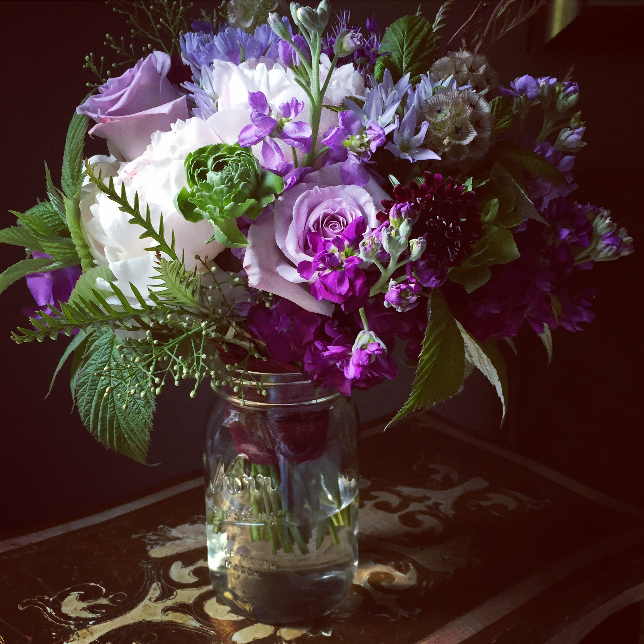 Bride's bouquet in purples with peonies and sweetpeas