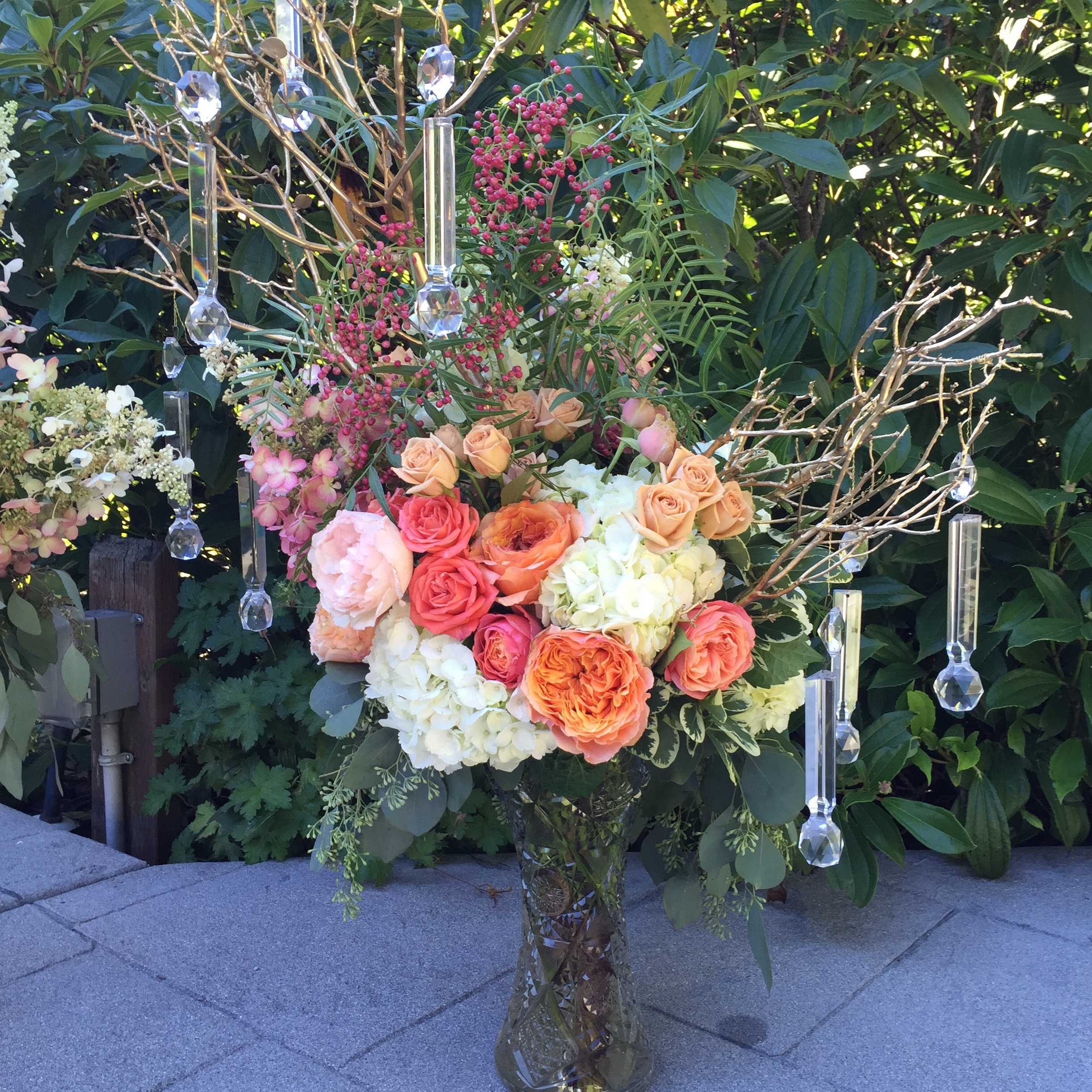 Ceremony arrangement in coral and peach