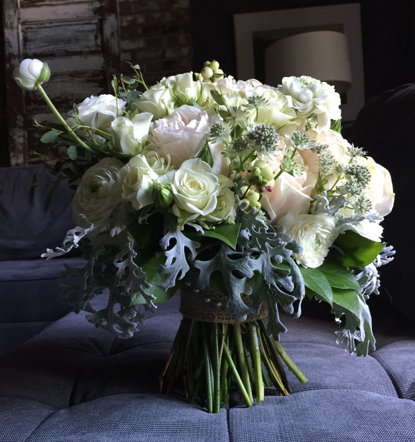 Blush bridal bouquet roses ranunculus and dusty miller grey