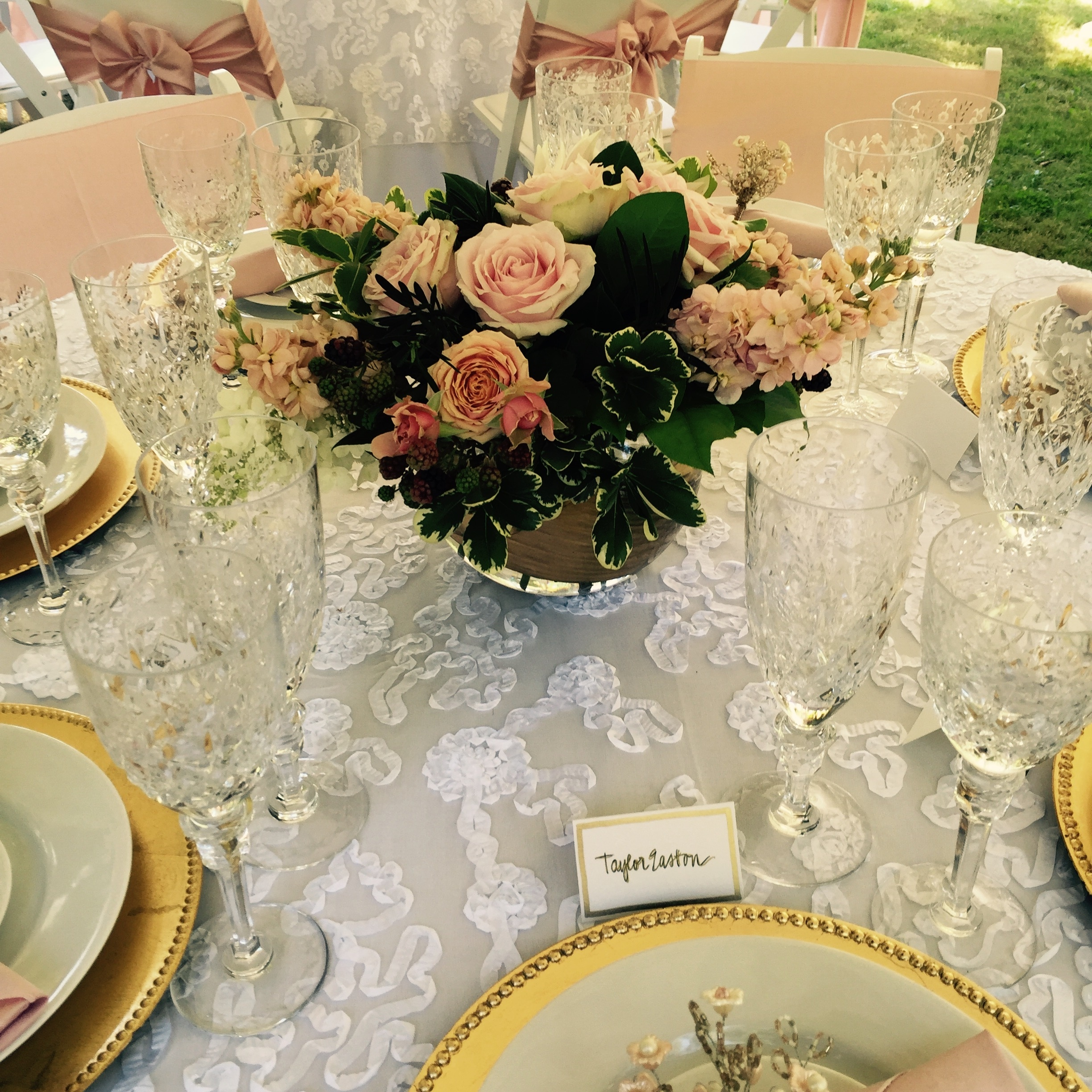 Blush centerpiece with hydrangeas, dahlias, stock, roses and gold accent