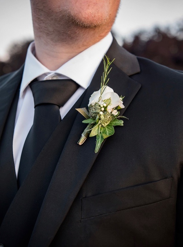 Groom's white boutonniere, rose, scabiosa buds, ivy
