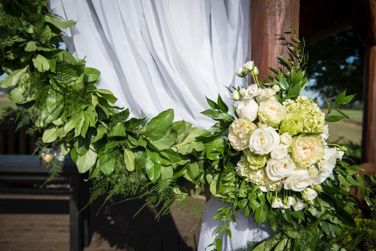 Green garland tieback. White flowers, roses, hydrangeas