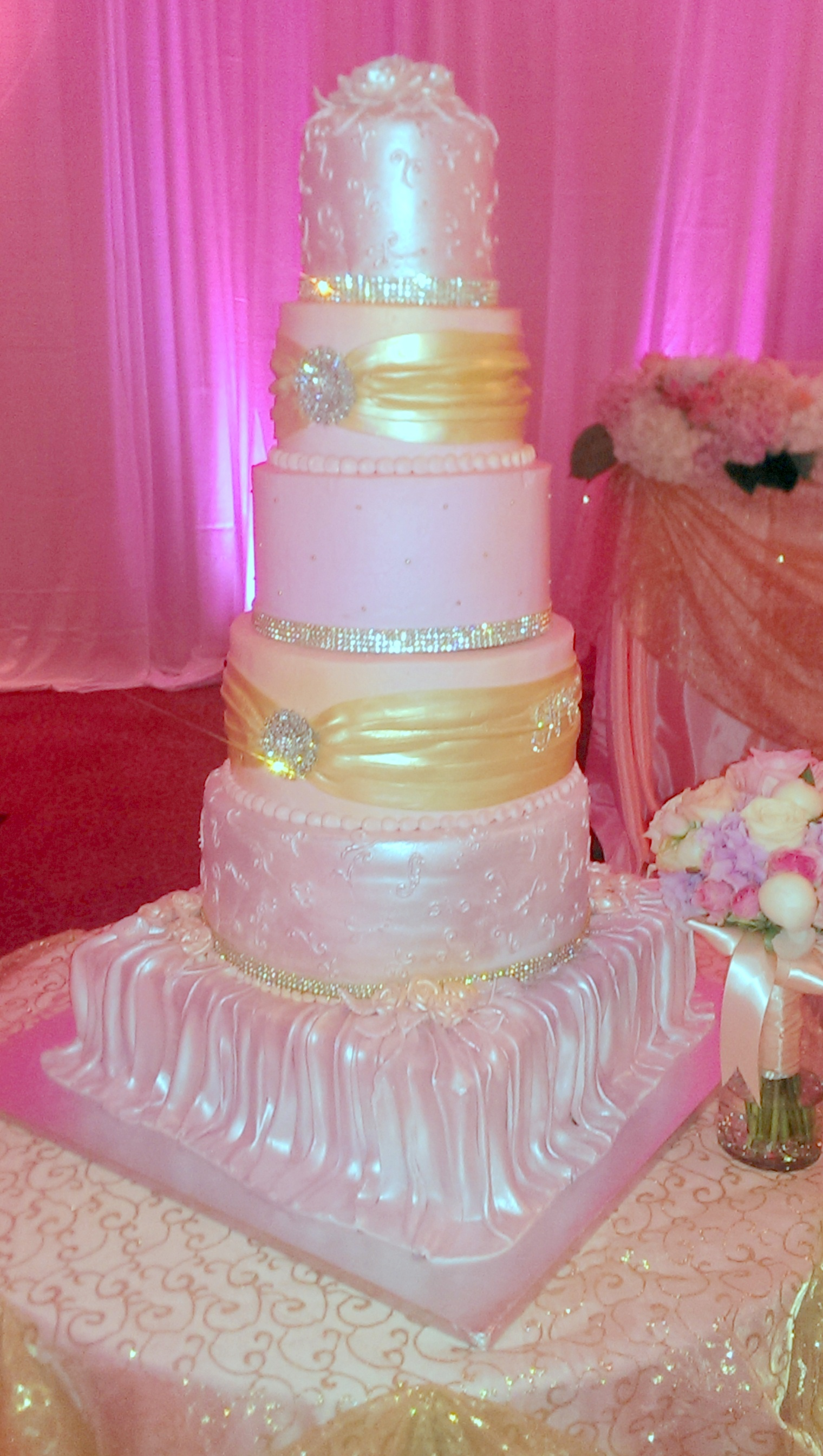 wedding-pink fondant draping, gold sashes.jpg