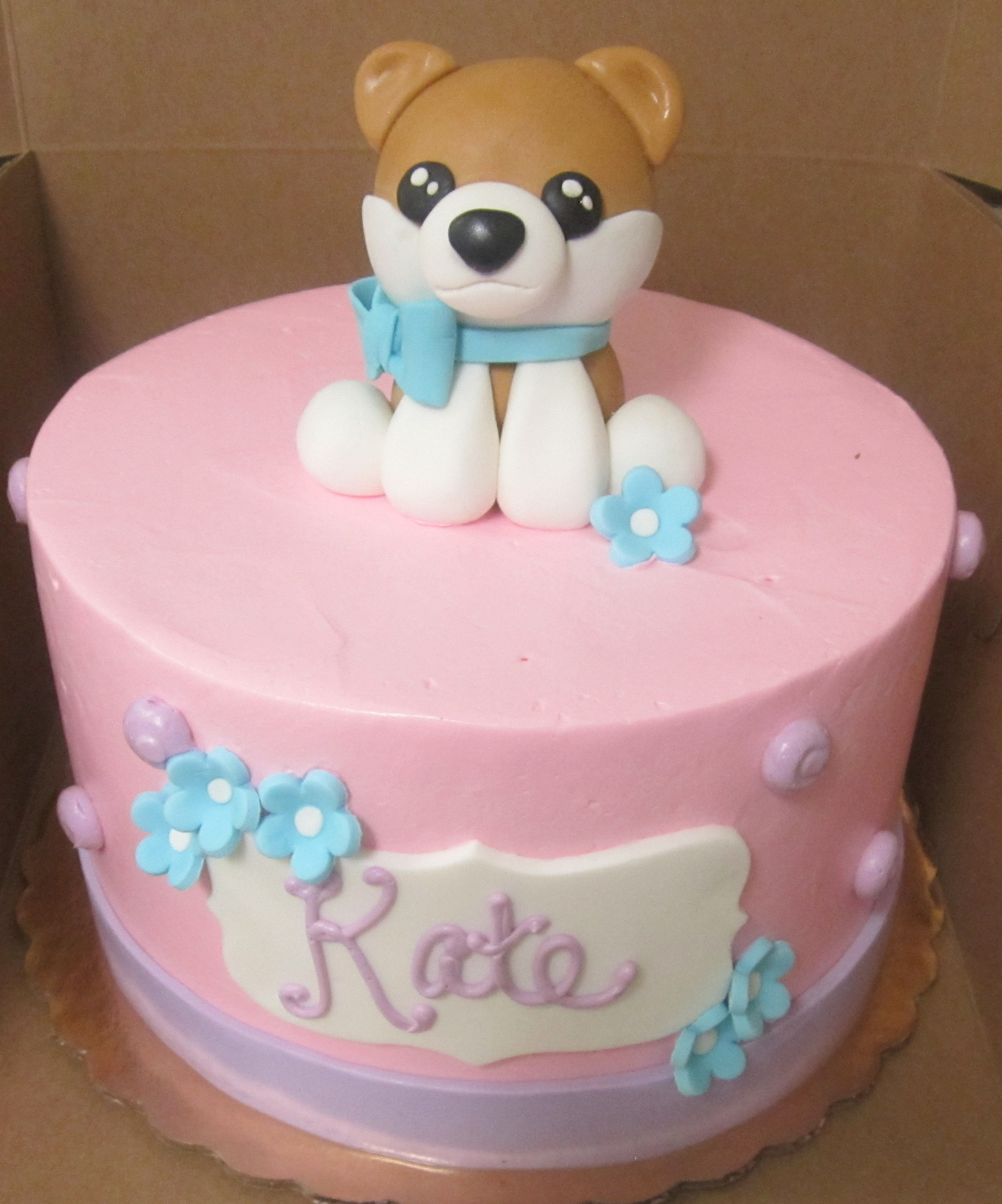 puppy on pink cake with plaque.jpg