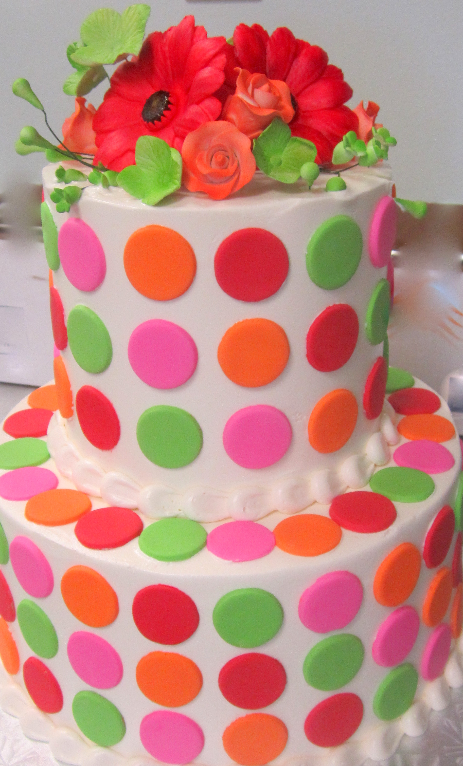rainbow fondant dots with flower topper.jpg