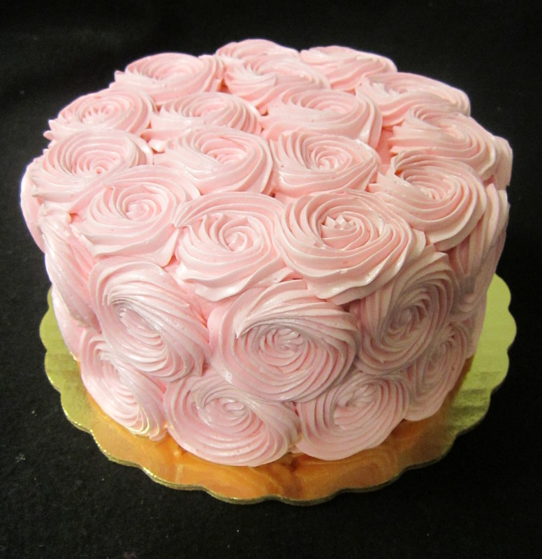 smash cake with light pink rosettes.JPG