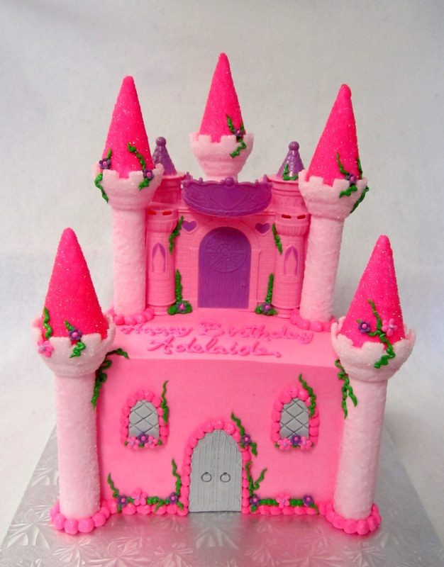 square cake with plastic castle topper.JPG
