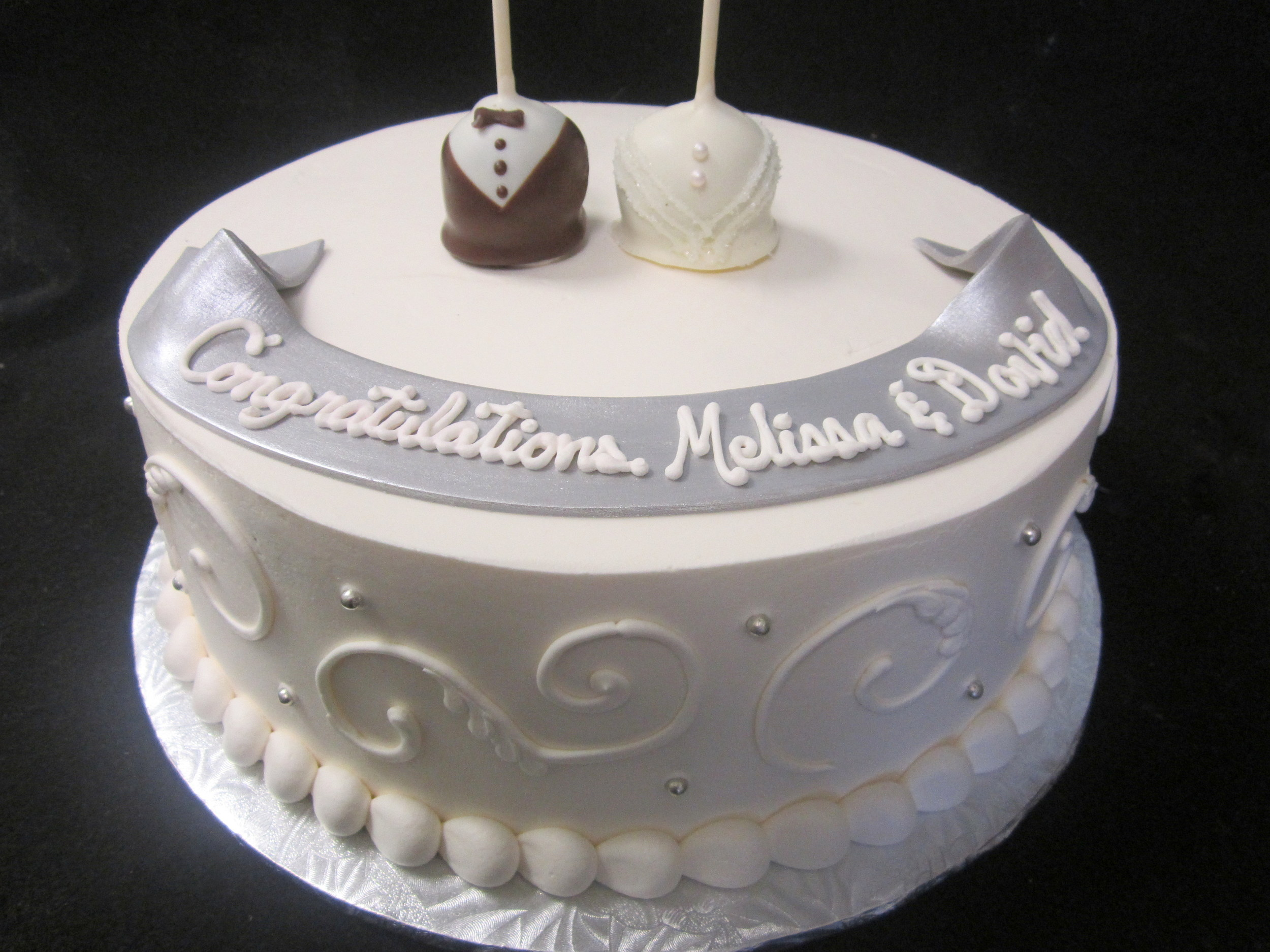 bride and groom pops on cake.jpg