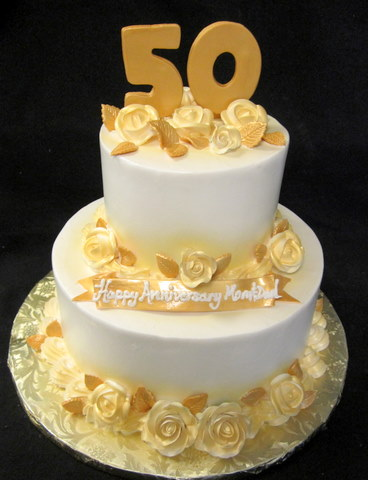 50 anniv with gold roses.JPG