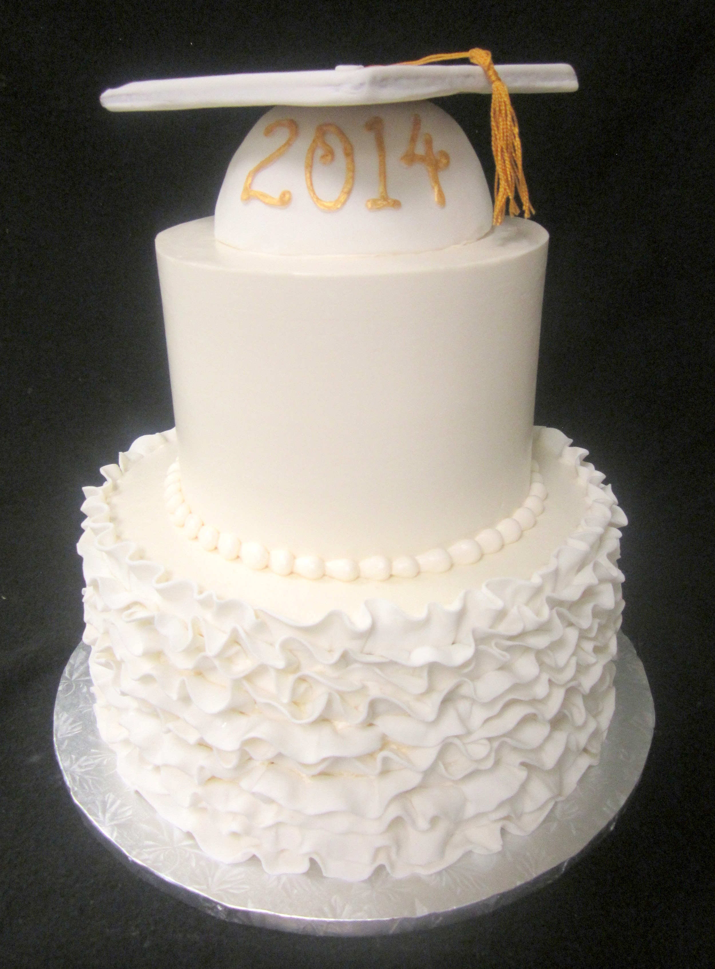 all white grad cake ruffles and cap.jpg