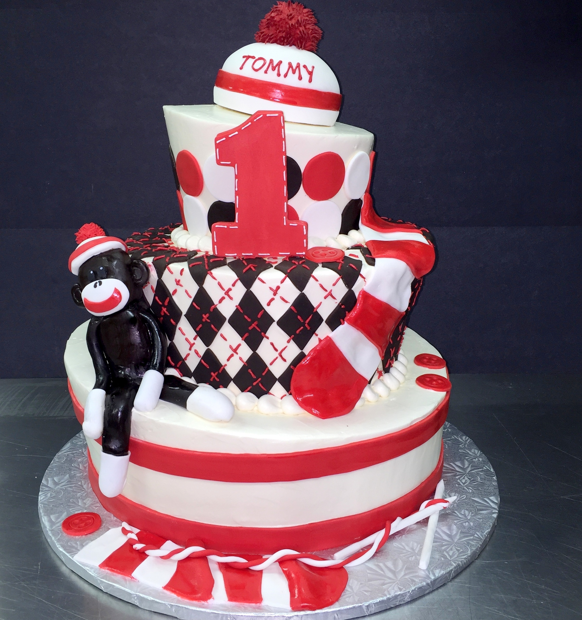 sock monkey three tiered cake.JPG