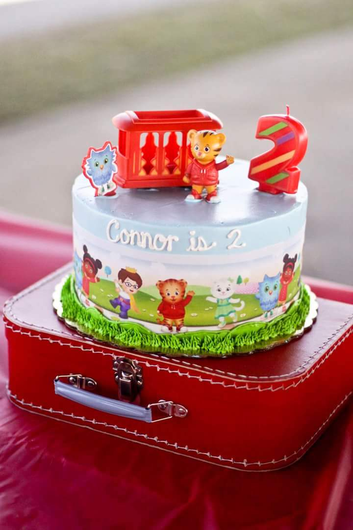 daniel tiger cake on suitcase.jpg