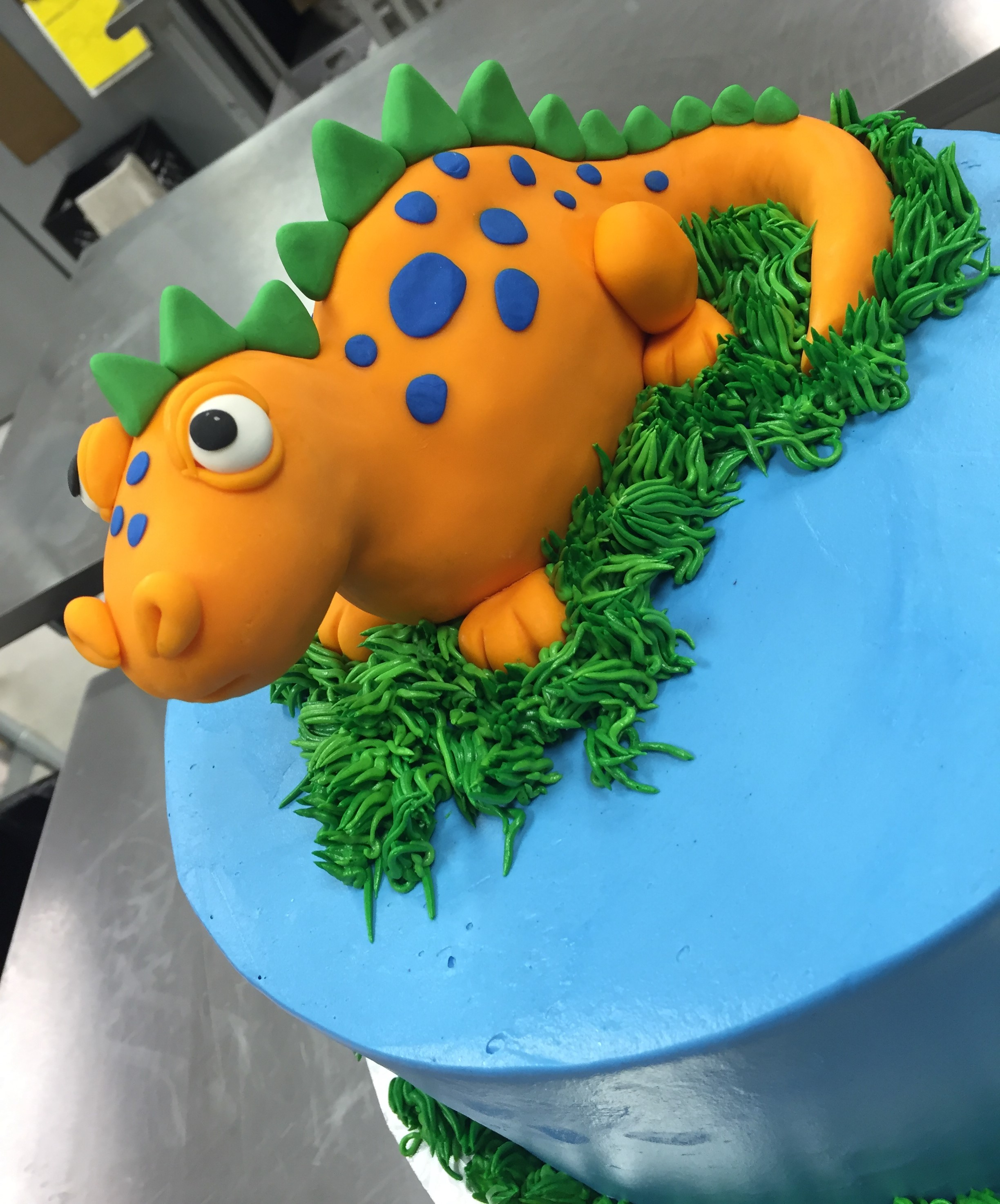 orange dinosaur cake.jpeg