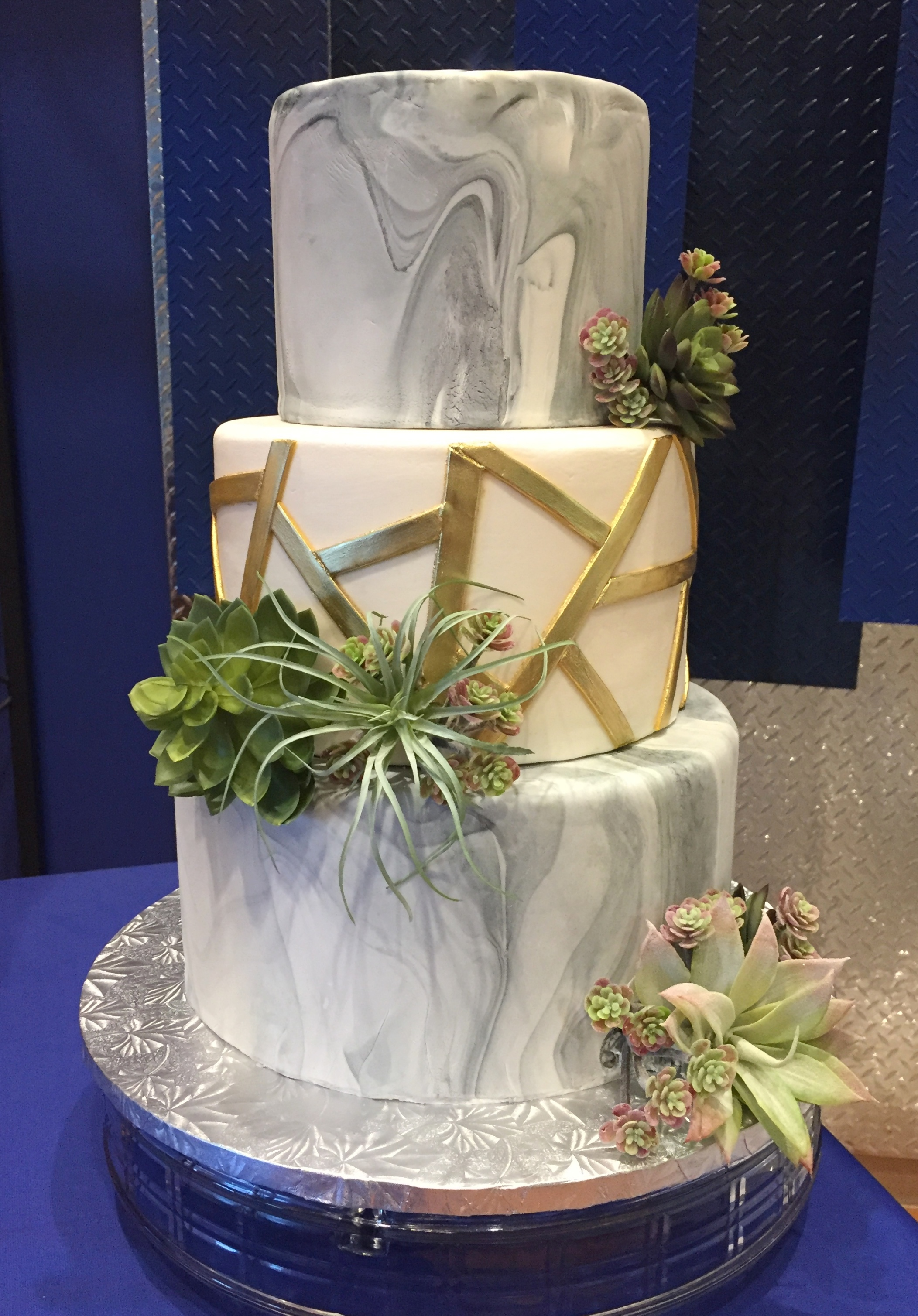 wedding cake - marbled fondant with succulents.JPG