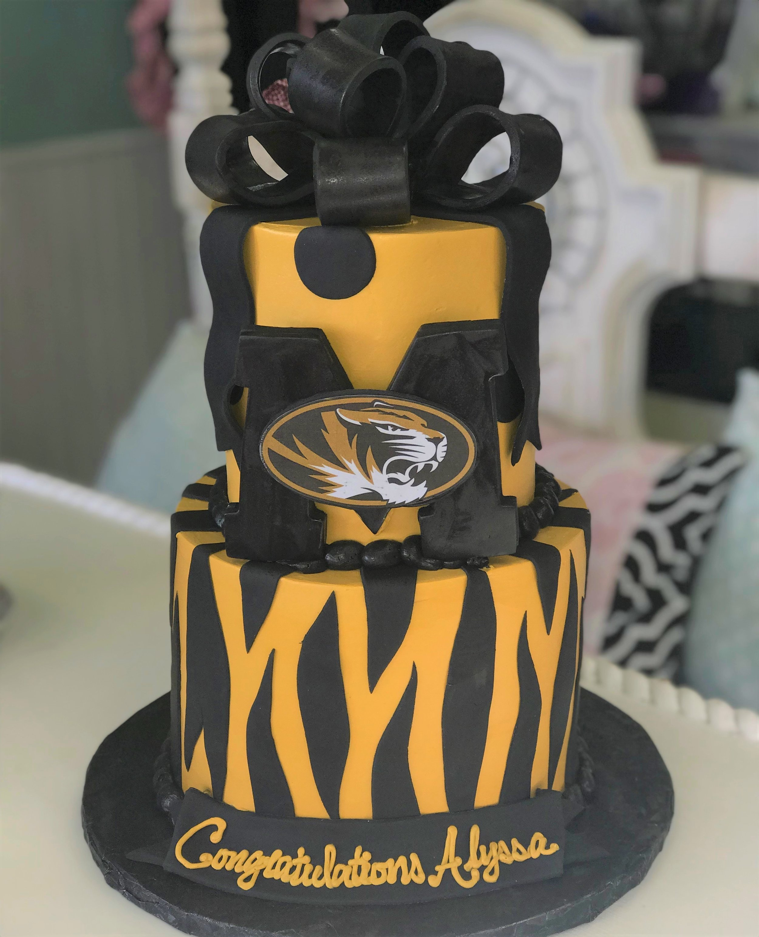 mizzou grad cake with bow and tiger stripes.jpg