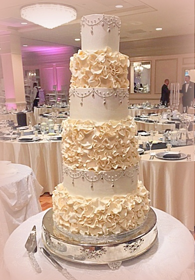 wedding cake - ruffle and silver chandelier.JPG