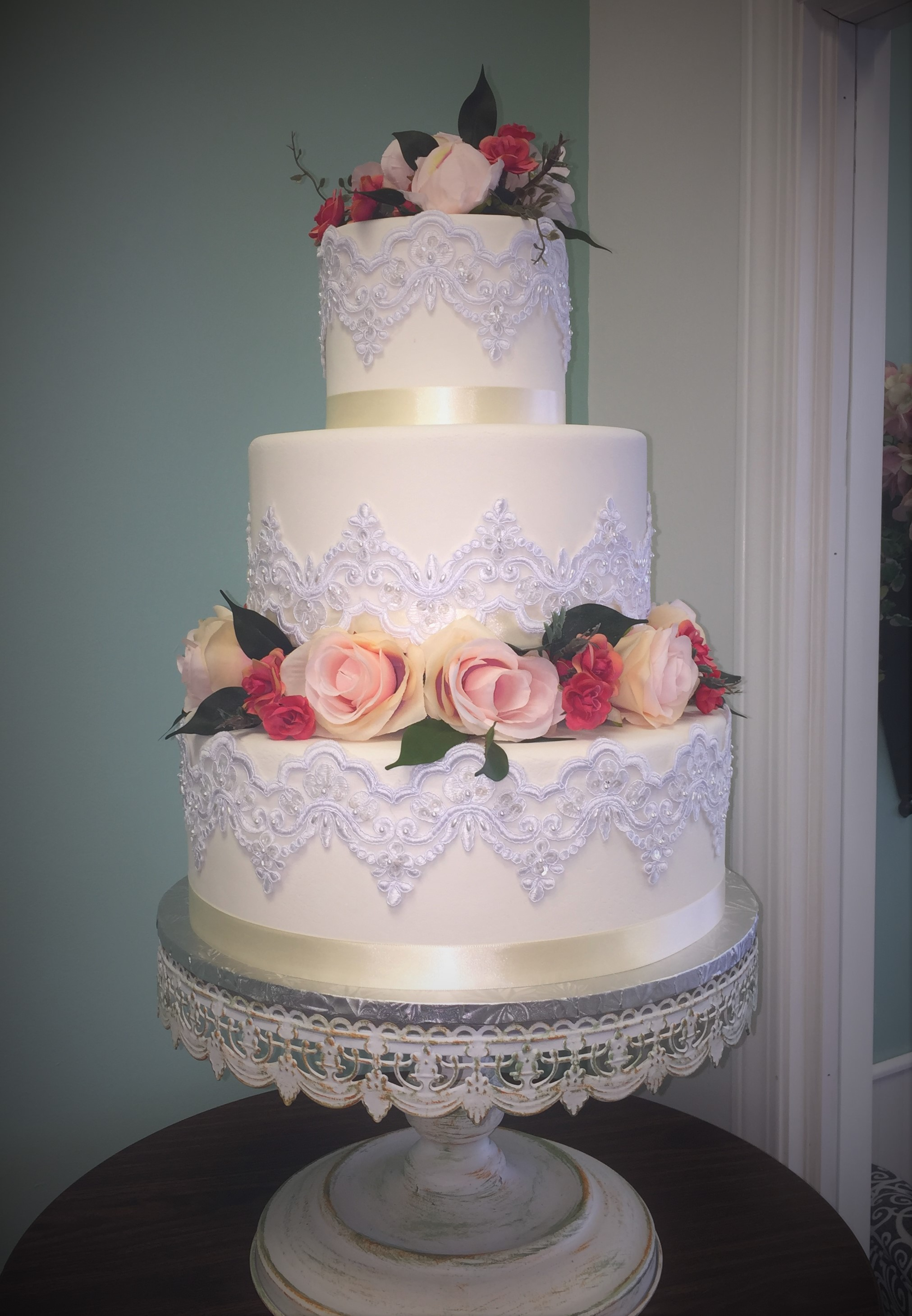 white chandelier lace and silk roses wedding cake.jpg