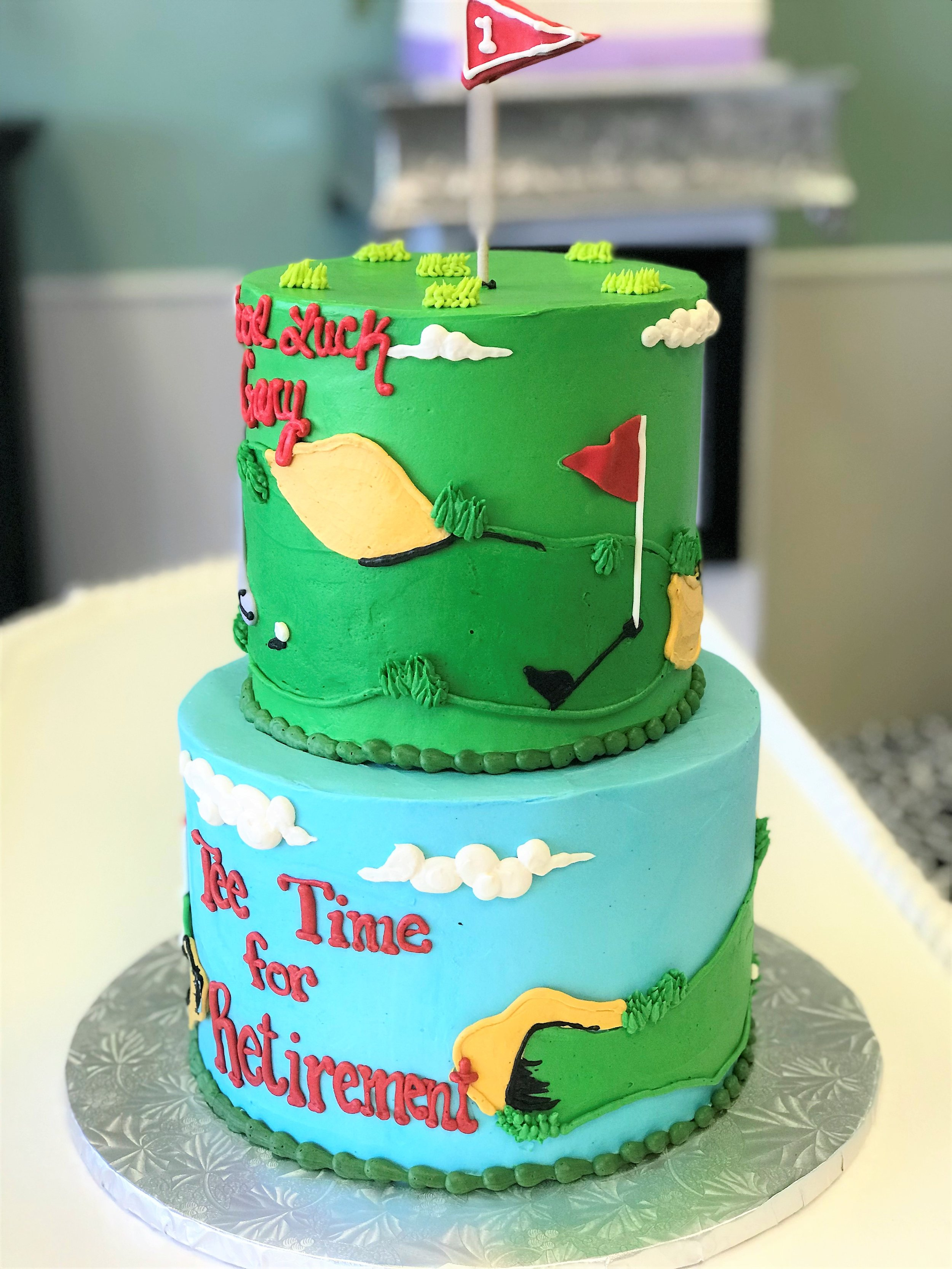golf retirement two tiered cake.jpeg