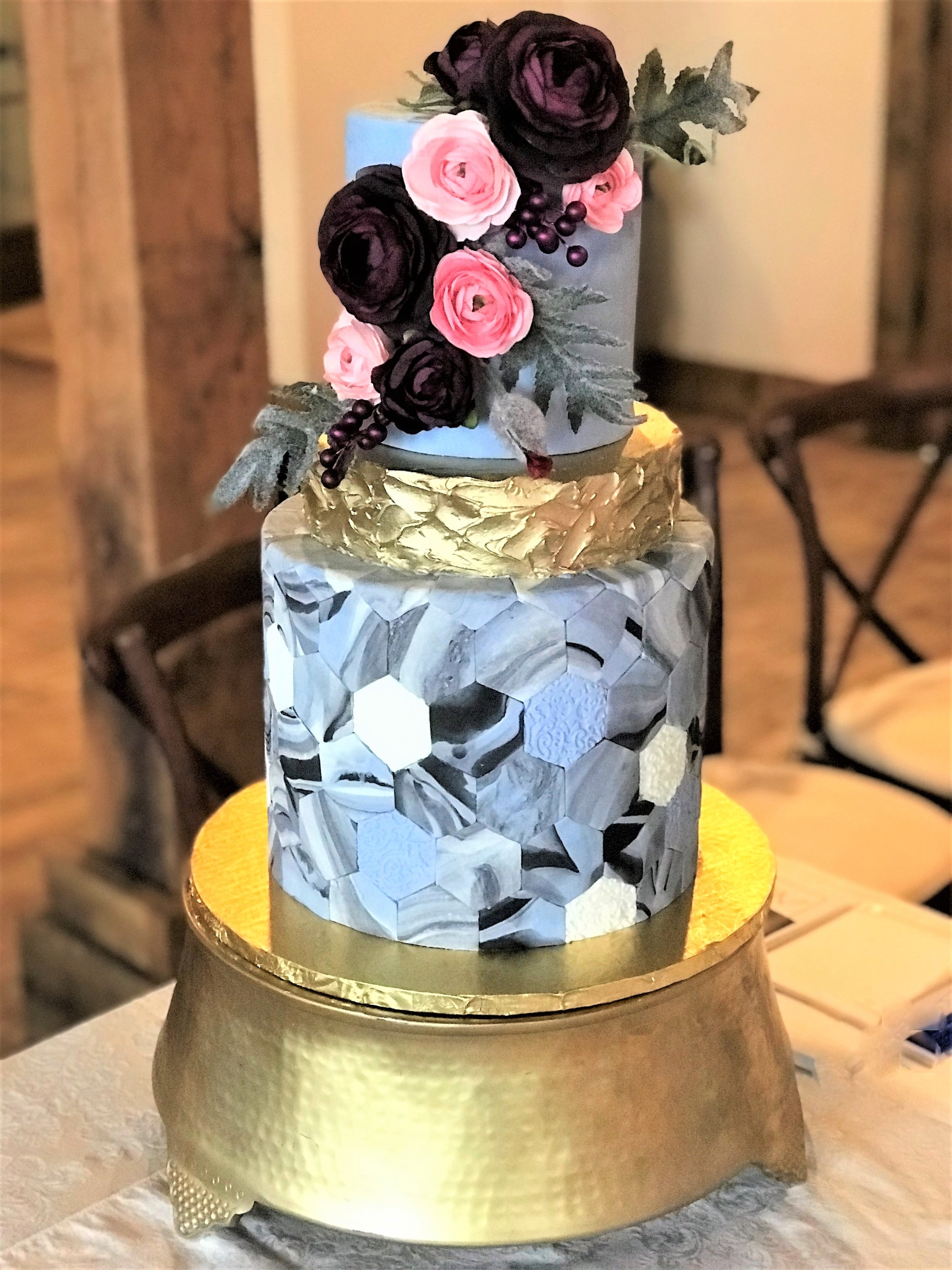 hexagon periwinkle wedding cake with gold middle tier.jpeg