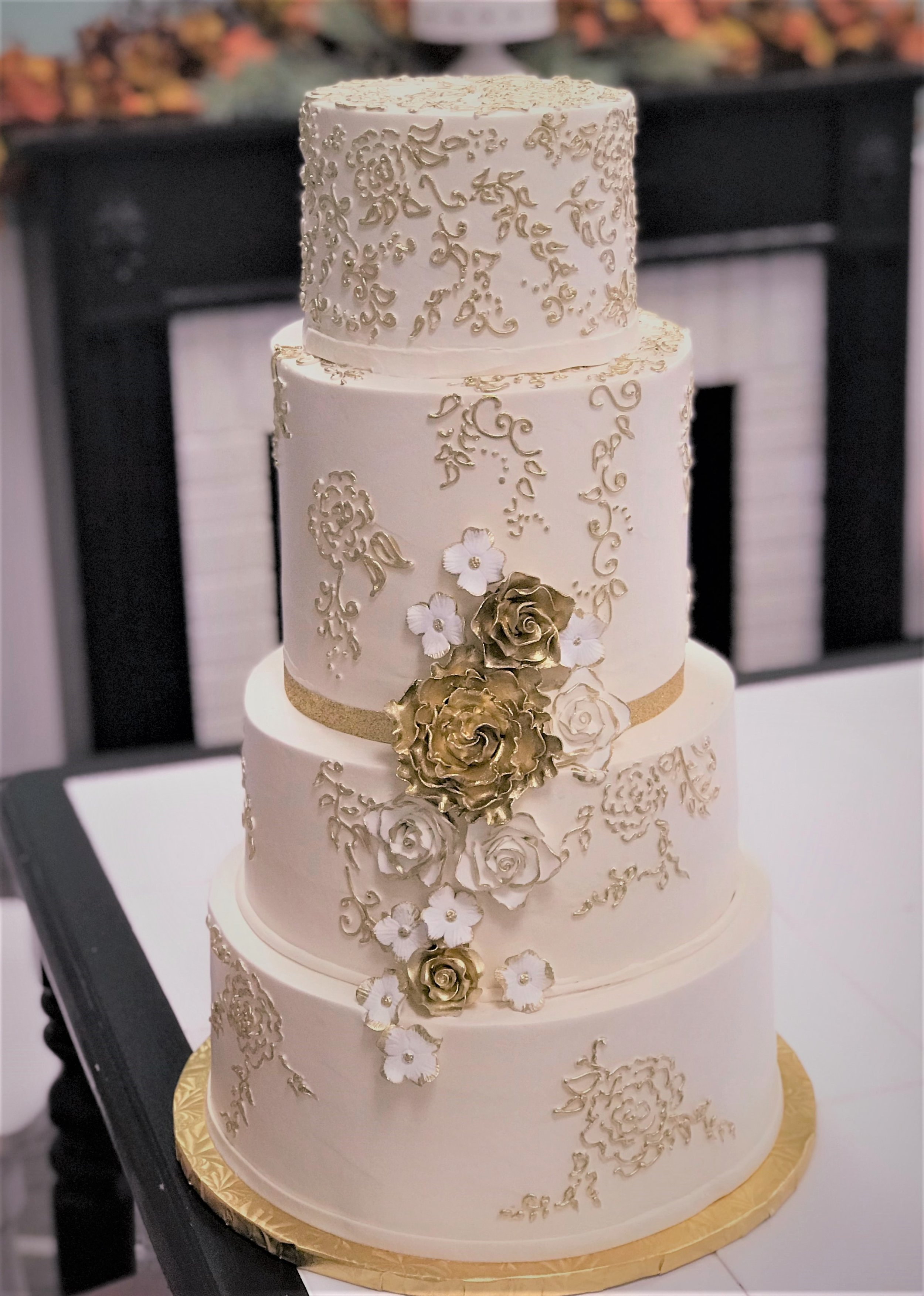 gold filigree and flower wedding cake.jpg