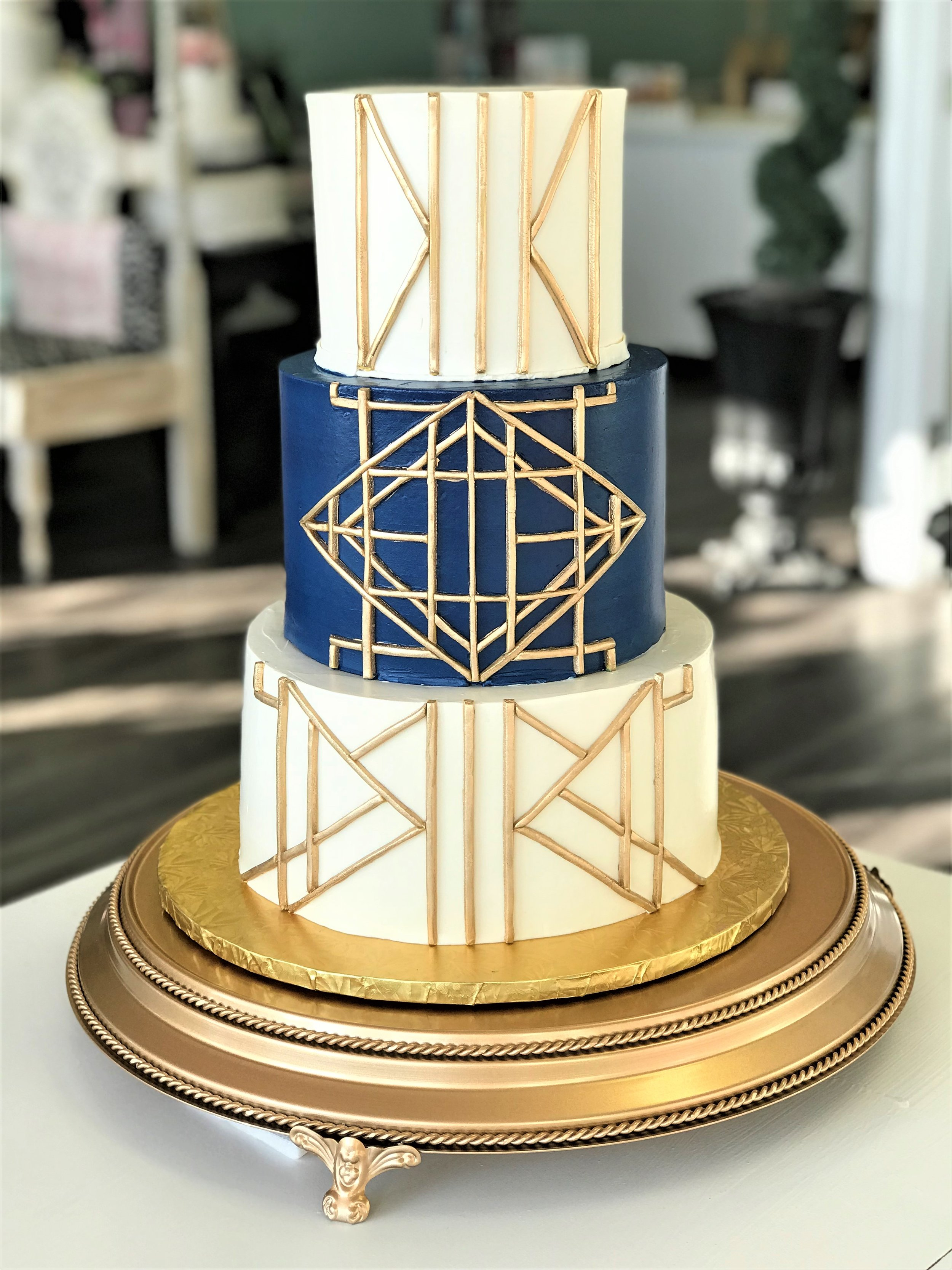 great gatsby geometric gold and navy wedding cake.jpeg