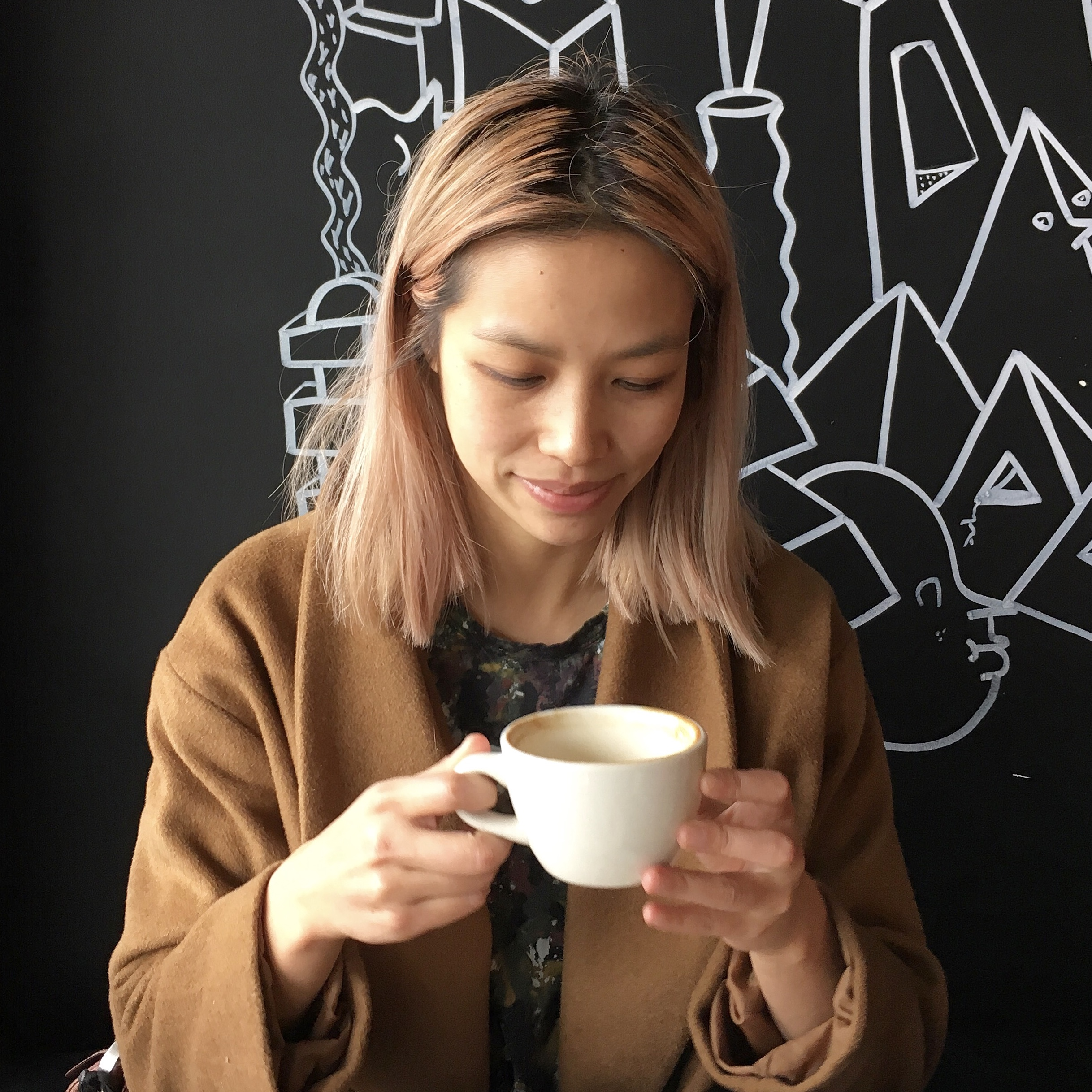 Jasmine Wong of Weta Digital conversation with James Butters from ai insights at Milk Crate Cafe Wellington City.jpg