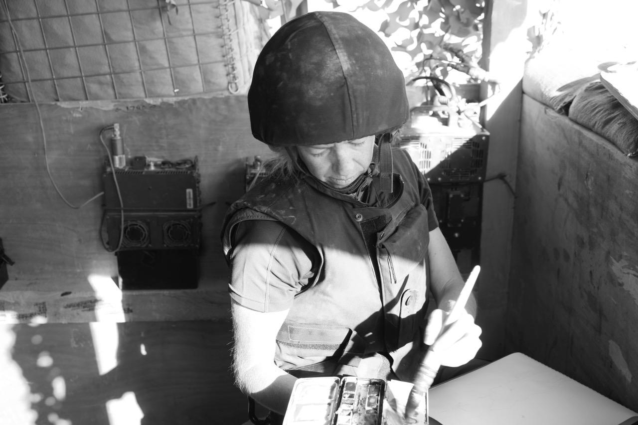 Arabella painting in warzone.jpg