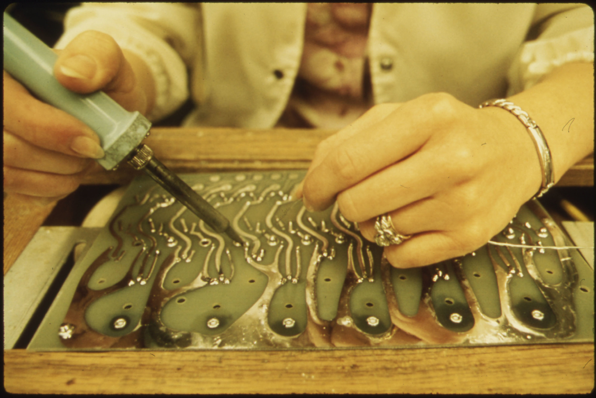 Closeup of an employee soldering. 3m company, new ulm minnesota.  by u.s. national archives