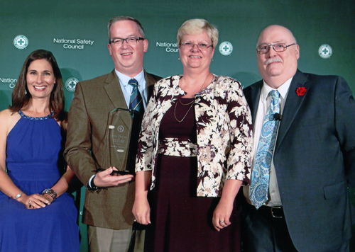 BrainWorks Multimedia President Barry Von Lanken, second from left, and CEO Lisa Von Lanken, third from left, receive the National Safety Council's 2015 Safety in Excellence in Highway Safety Award for Driving Safety Training Program Innovations from NSC President and CEO Deborah Hersman, left, and James Solomon, right, program development and training director. Photo courtesy BrainWorks Multimedia
