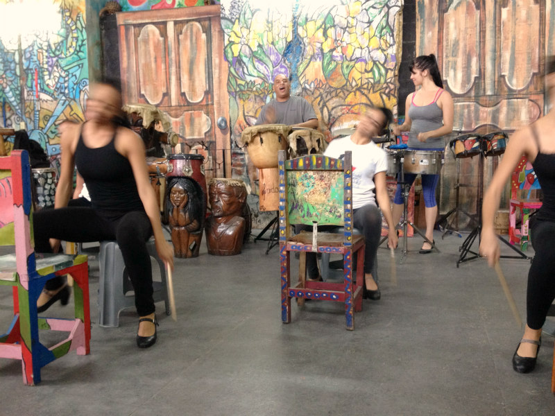 At Havana Compass Dance, these energetic, very talented young ladies (who never stopped smiling!) learn a traditional style of Cuban drumming on hide-covered chairs. These chairs have long been used by farmers all over the island and have become a symbol of Cuban pride. Privately owned, this dance company provides free instruction to all. The center is supported by performances, selling original art made by their founder, and accepting donations.