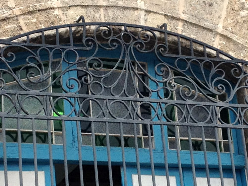 An example of Spanish Colonial ironwork, this one set in front of stained glass in one of Havana's four main plazas. Cienfuegos, Trinidad and Havana are brimming with 19th century ironwork, Neoclassical architecture, and cobblestone streets. A step back in time!