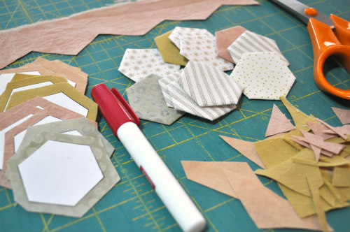 "1"" hexis cut from paper and wrapped with fabric. I'm a fan of glue basting."