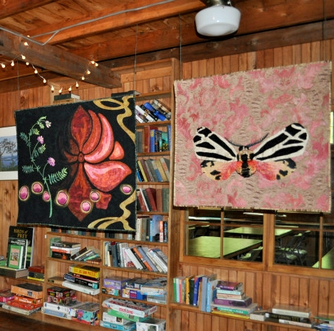 Metamorphosis and Self Portrait side by side in the cozy Deephaven Library, 2018.