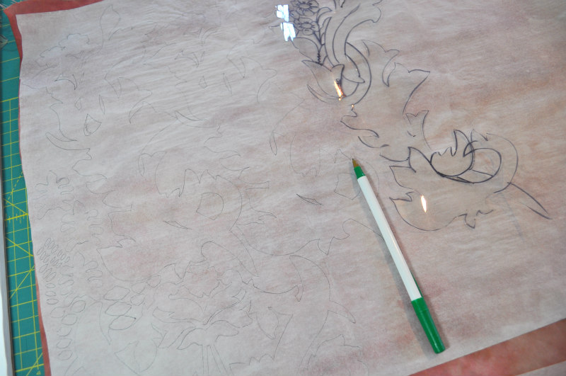 Tracing shapes onto paper-backed fusible web.