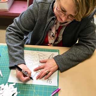 Marion Lutz tracing her lovely design.