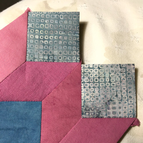 I stitched two squares at each outside corner before adding the third, forming the block's corner.