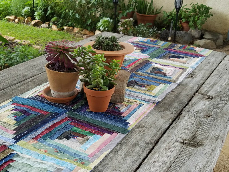 Picture perfect, Barbara's log cabin table runner is ready for company!