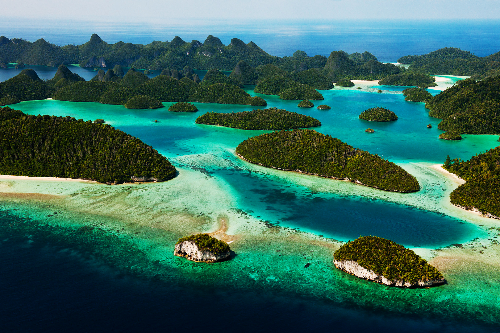 The islands of Raja Ampat are all made of limestone, a former reef which has risen above the water by the historic drop in sea levels. Easily eroded, the minerals from the sea mounts form beaches and buffer the calcium levels in the water.