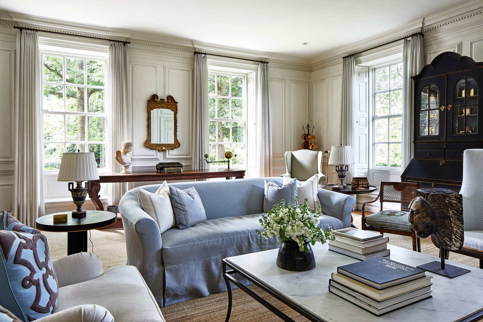 Decorating firm Simon-Wallace designed the living room, but many of the pieces are antiques that have been in the family for years.