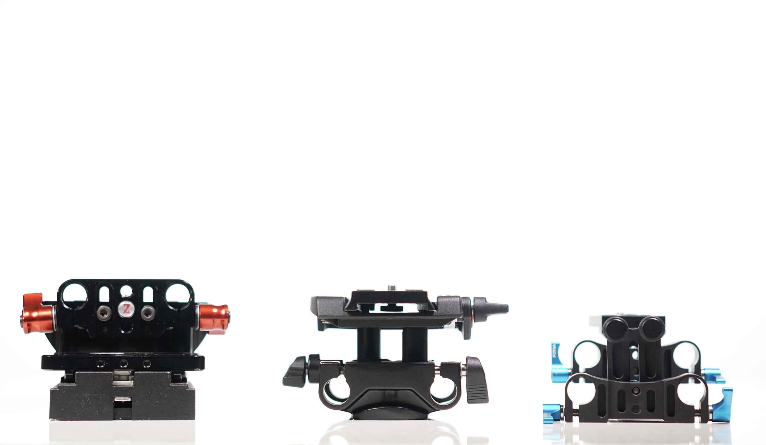 Left to right:  Zacuto ,  Sachtler  and  FOTGA . They all use 15mm rods, they all rise to about the same height -- but that's pretty much where the similarities end.