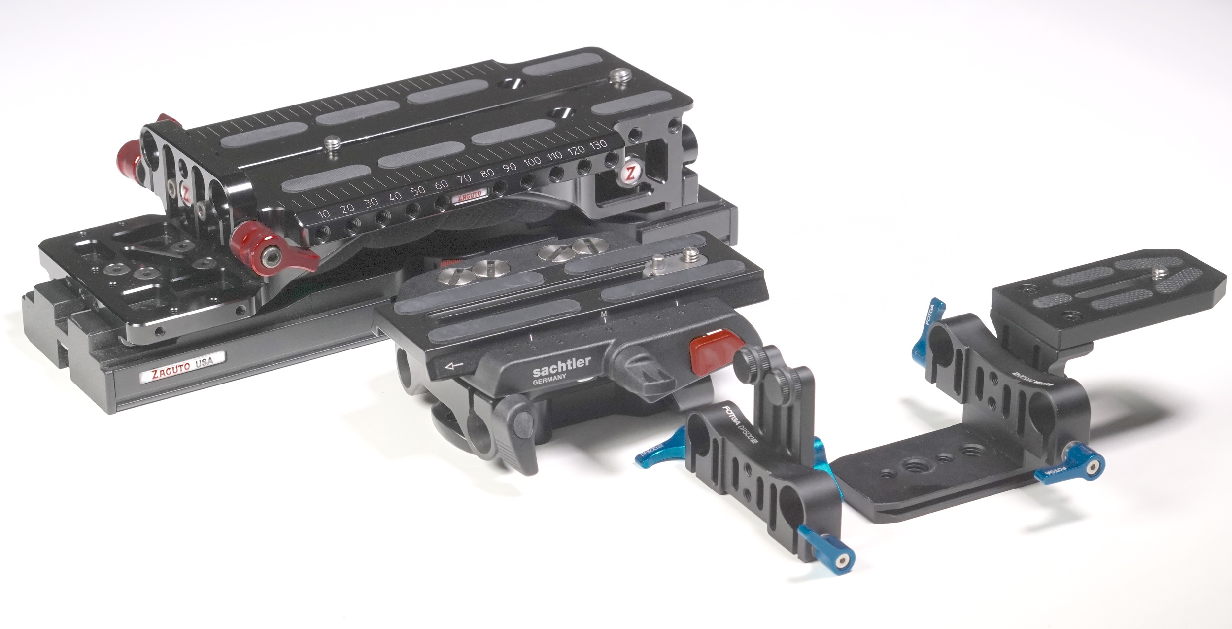 Left to right:  Zacuto VCT Universal Baseplate  and  Tripod Plate ,  Sachtler Ace Base Plate , and  FOTGA DP500  equivalent (notice that the FOTGA locking clamps are separate assemblies).