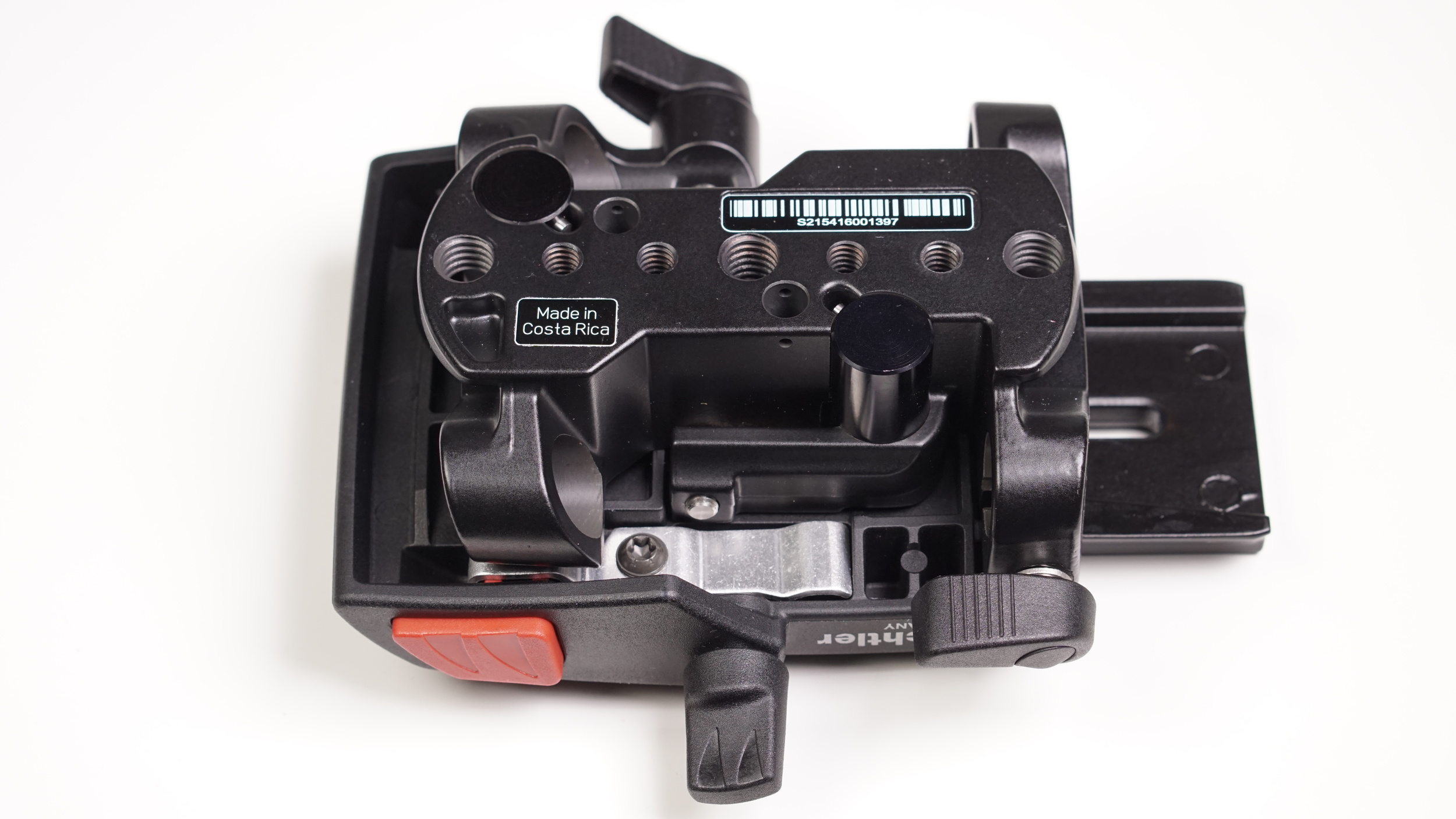 The underside of the Sachtler Ace base plate is the best angle to appreciate the forethought and complexity that goes into its design: many mounting points, robust, solid metal riser rods, differently sized and shaped levers fit to purpose, elegantly shaped core block - wow.