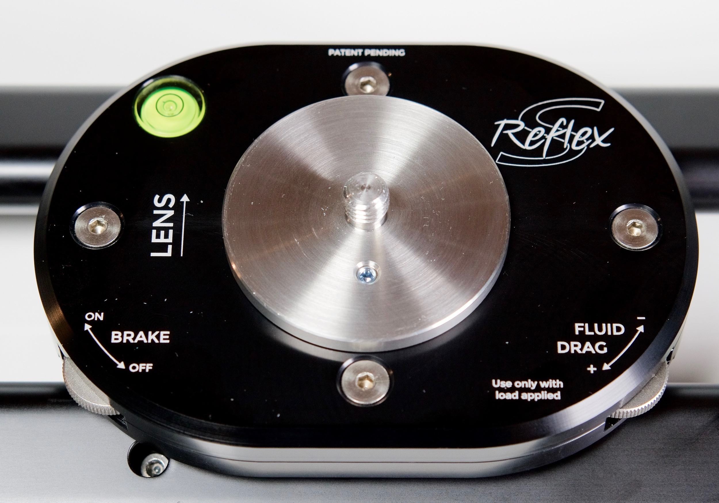 """First time I've seen fluid drag on a slider. I double-checked to confirm it really is fluid drag. Confirmed directly from SmartSystem: """"The reflex s has the fluid friction instead of the old version (reflex without s) that has an old friction system."""" Just make sure the brake is turned completely off, a  nd don't adjust the drag until you've got your camera and head attached to the tray."""