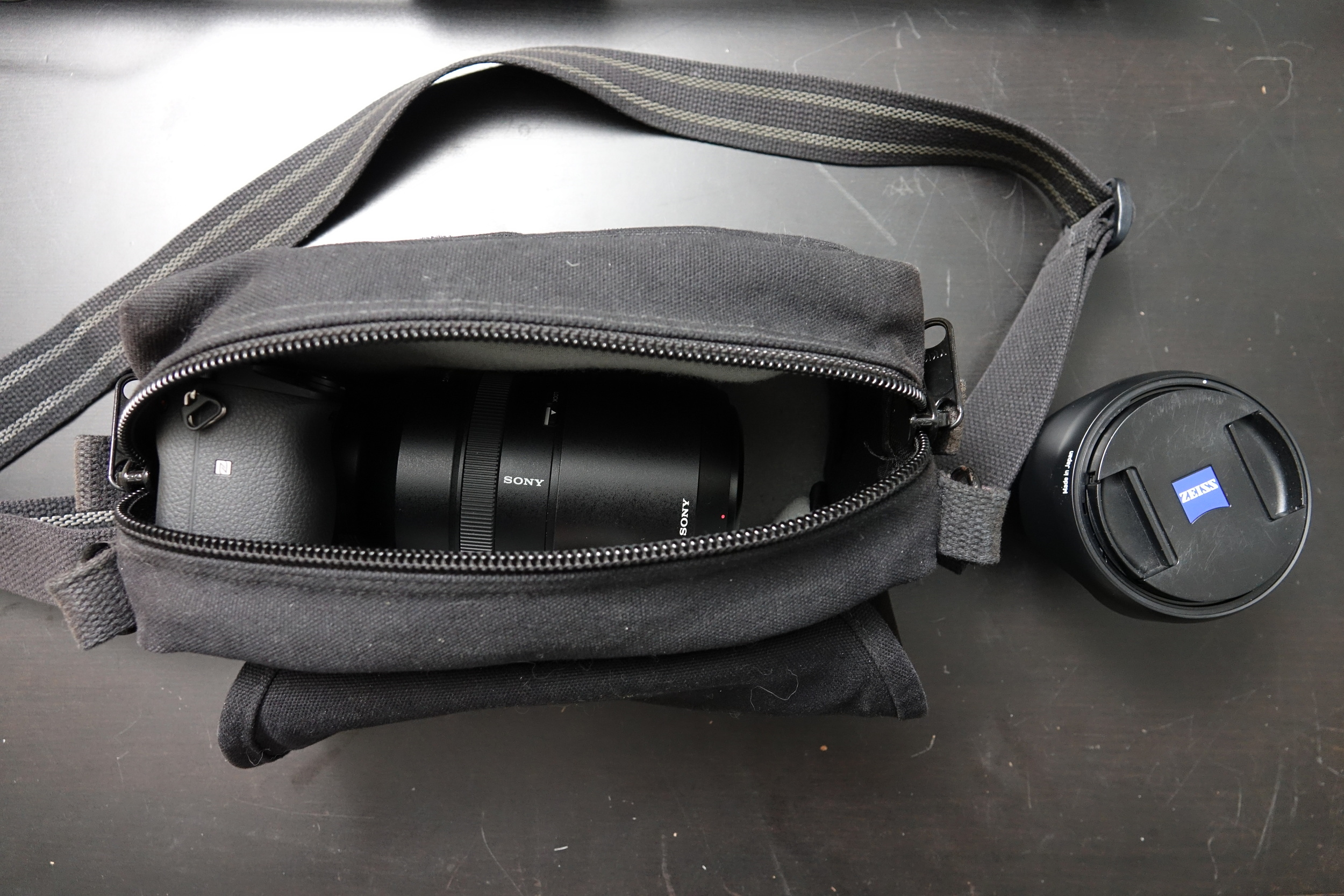 Domke F-5XB is a very small, unassuming and very comfortable shoulder/belt bag, but it requires compromises when packing. Inside: Sony a6300 with Sony FE 70-300mm f/4.5-5.6; outside, Zeiss Batis 18mm f/2.8