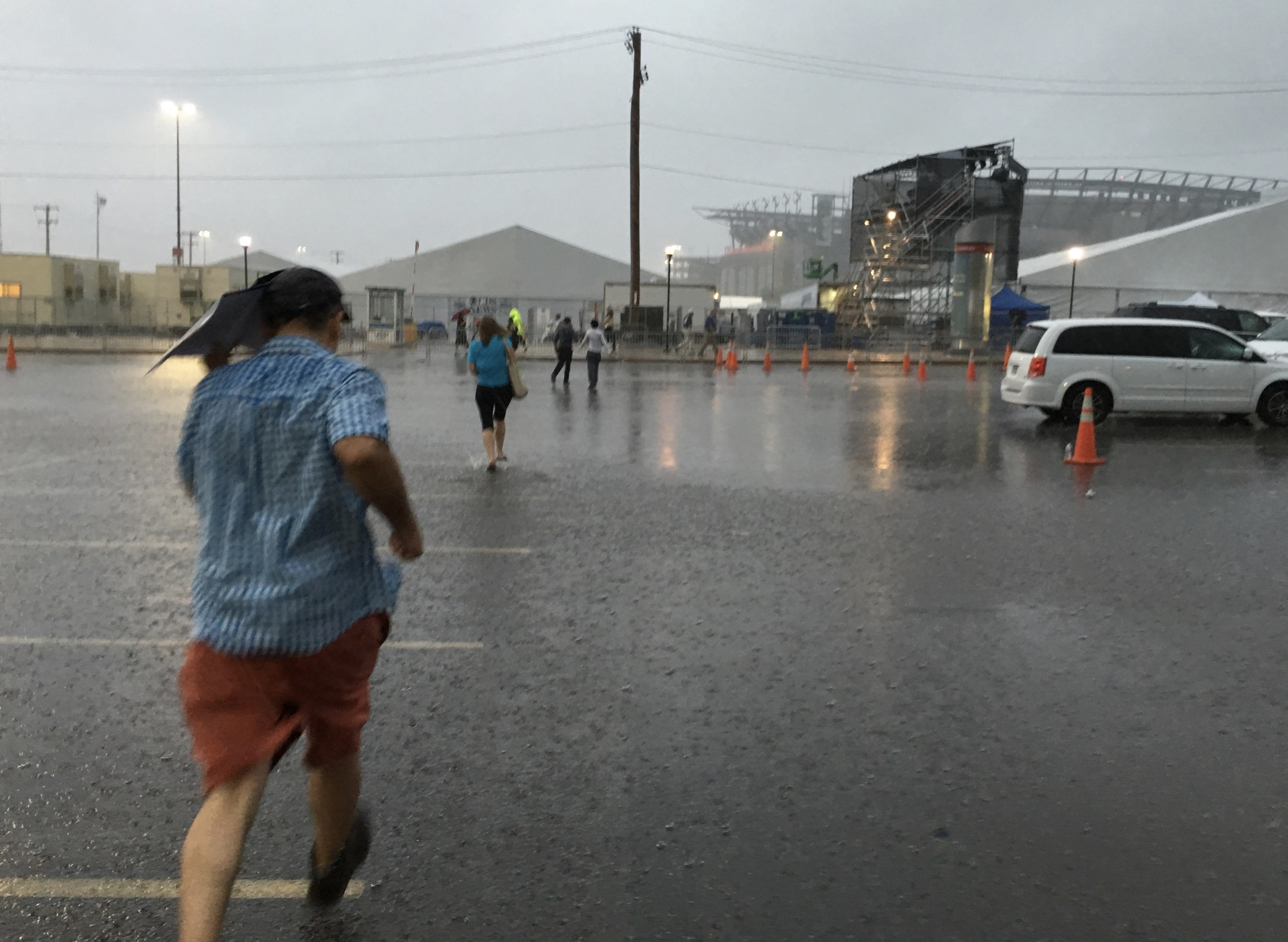 Racing through flash flood from the bus to the security tent at the DNC. iPhone 6s+ ISO 40, f/2.2, 1/15. Out in a jiffy, I didn't mind that it got wet. It was just fine. I think the Schneider iPro case helped.