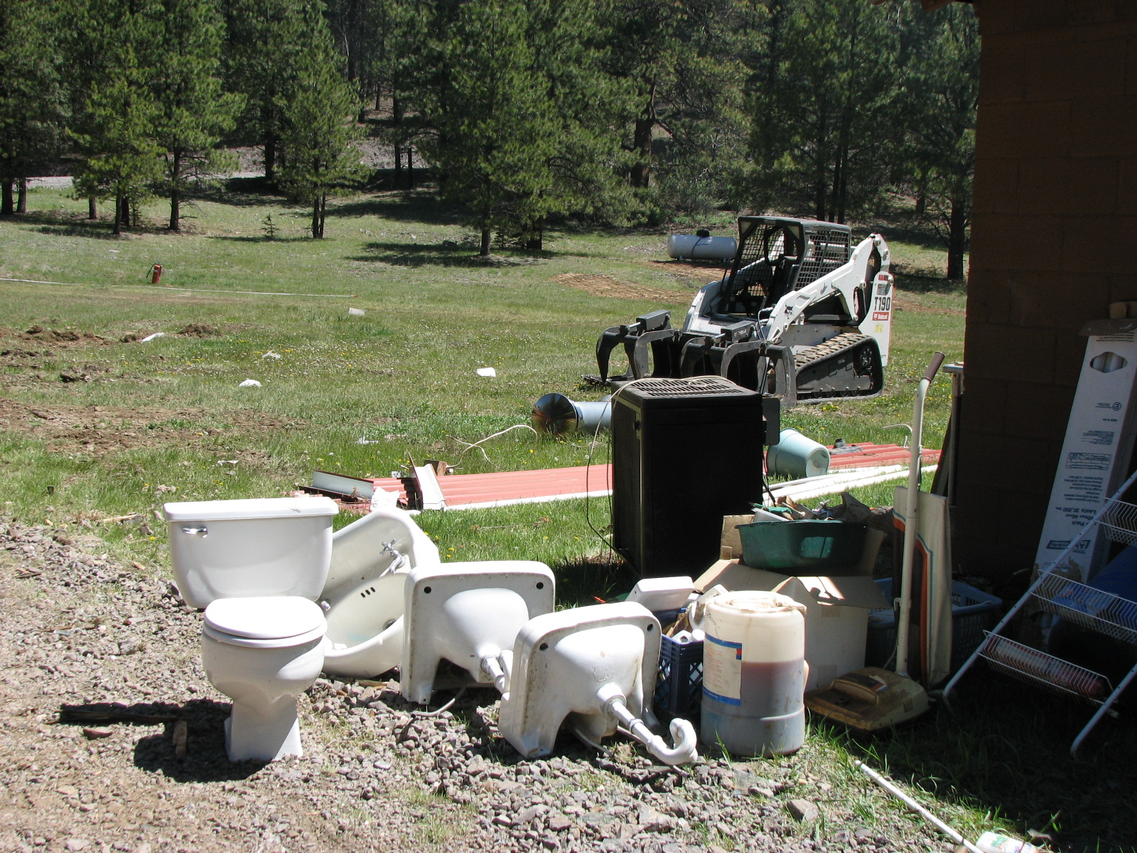 Out with the old, broken toilets & sinks